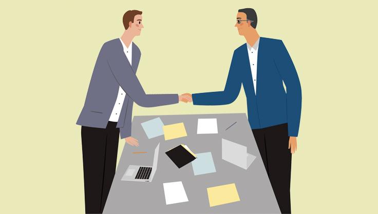 medarbejderudviklingssamtale-medarbejder-og-leder-giver-hånd